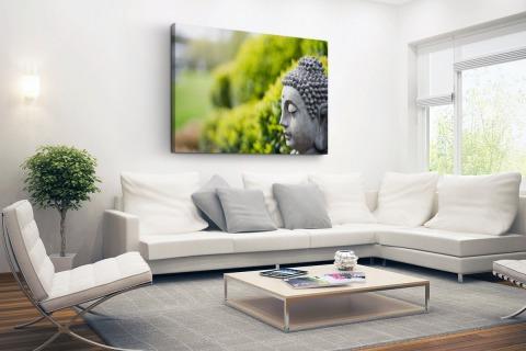 Standbeeld van Boeddha in een tuin Canvas