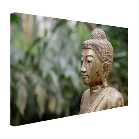 Oud Boeddha standbeeld in een tuin Canvas