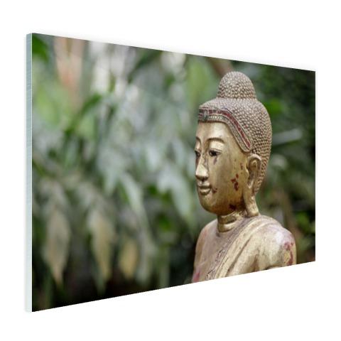Oud Boeddha standbeeld in een tuin Glas