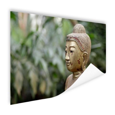 Oud Boeddha standbeeld in een tuin Poster