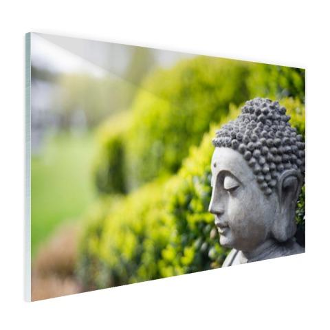 Standbeeld van Boeddha in een tuin Glas