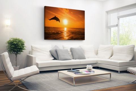 Springende dolfijn bij zonsondergang Canvas