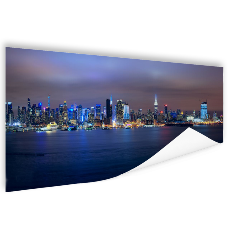 Skyline van New York City bij nacht Poster