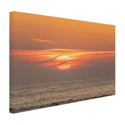 De zonsondergang in de zee op canvas